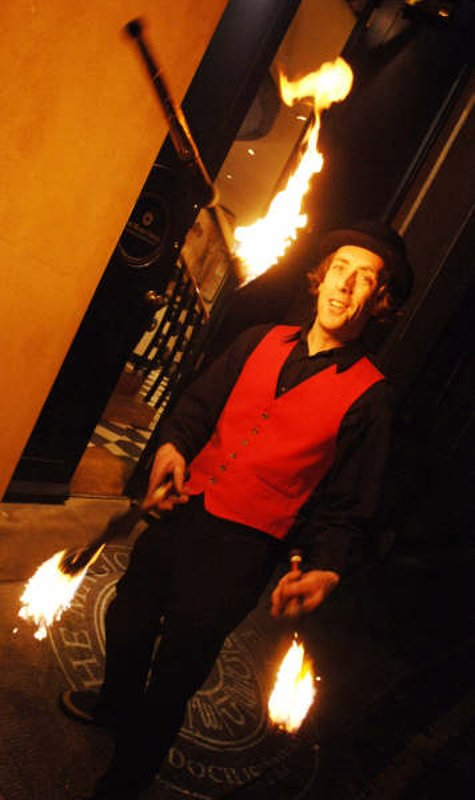 Fire Juggler with fire clubs