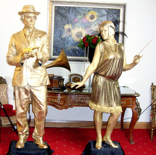 Gold 1920's statues