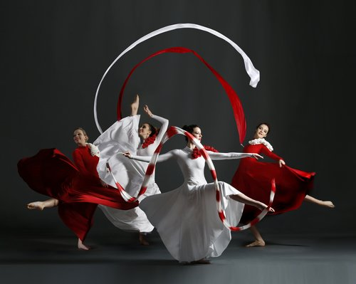 red and white ribbon dancers