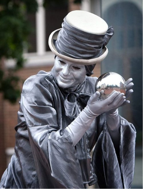 Silver lady with crystal ball head shot