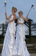 greco-roman stilts with torches