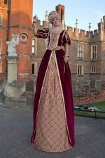 female tudor stiltwalker