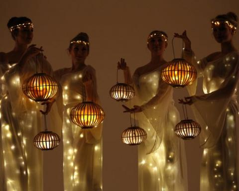 Greek lantern stilt walkers
