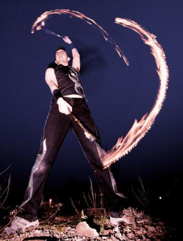 Fire Performer with fire swing
